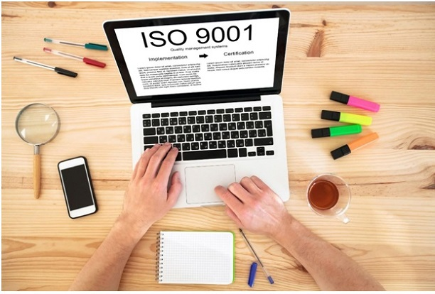 laptop showing steps for ISO 9001 implementation